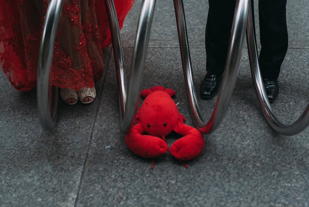Bride and groom in toronto financial district with pinchie the lobster