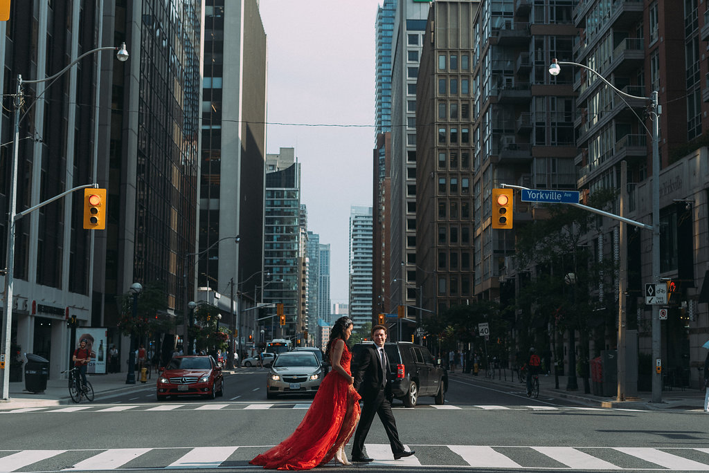 Bride and groom crossing yorkville street in toronto engagement shoot photo ideas