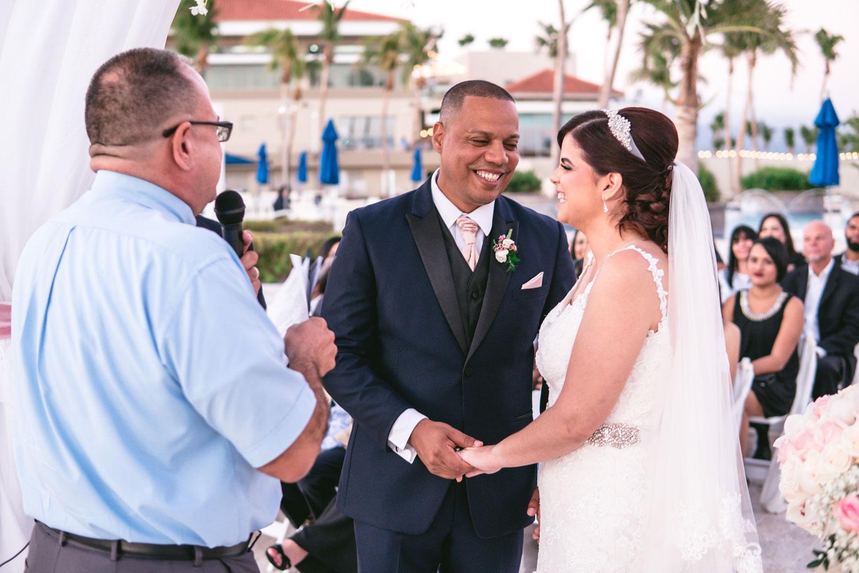 Bride and groom poolside wedding ceremony in puerto rico wedding after hurricane maria