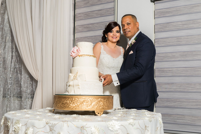Bride and groom cutting wedding cake wedding puerto rico after hurricane maria