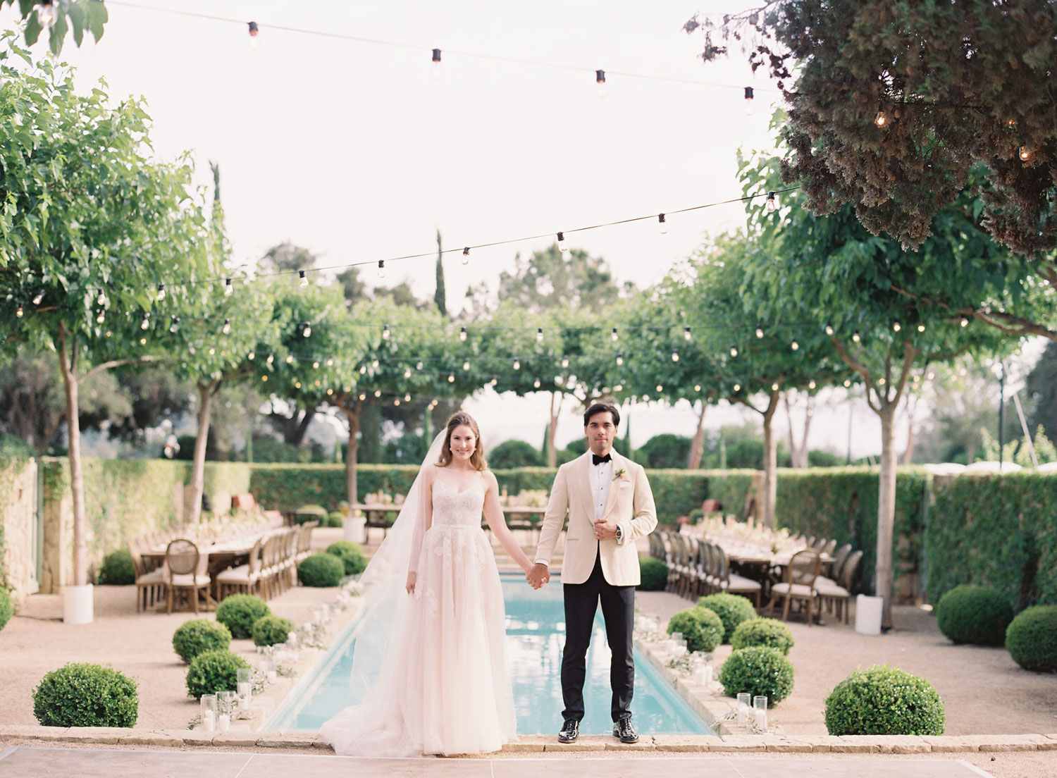 Bride and groom portrait by reflection pool wedding in california
