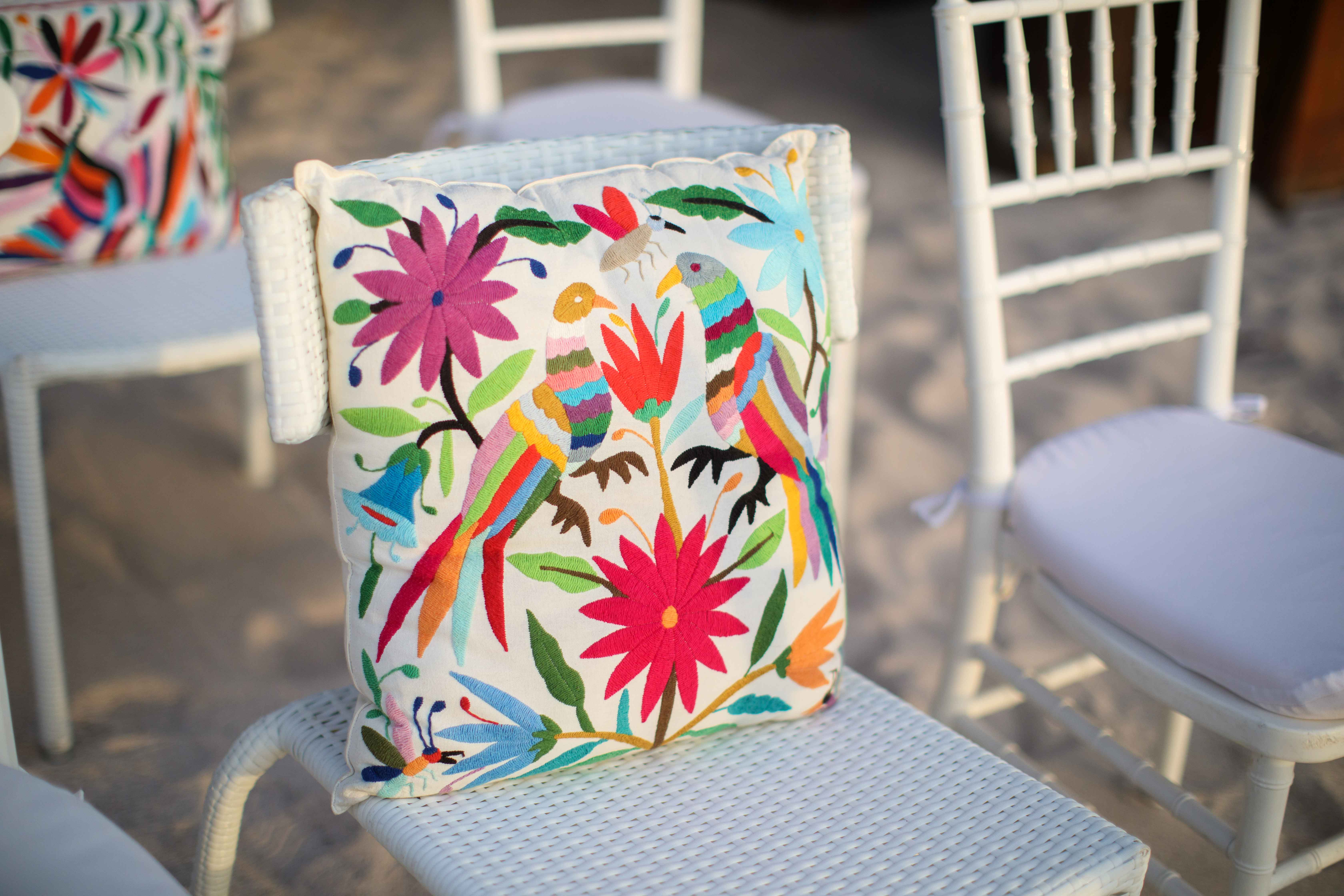 Brightly colored pillow fun Mexican print wedding ceremony ideas