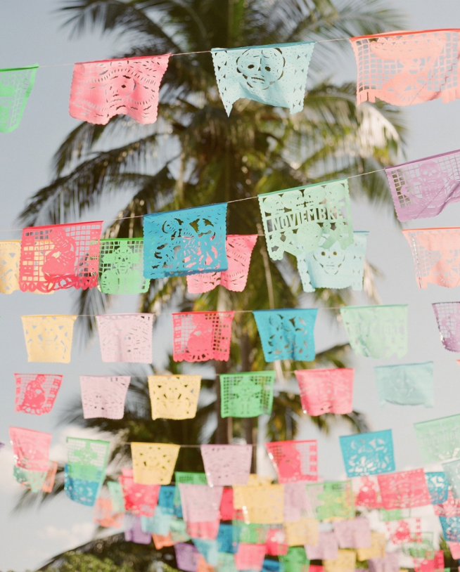 Papel picado fiesta flags hanging for mexico rehearsal dinner wedding decorations