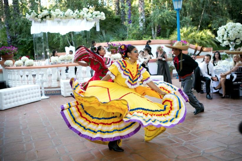 traditional Ballet Folklórico de México dancers at wedding reception courtyard reception