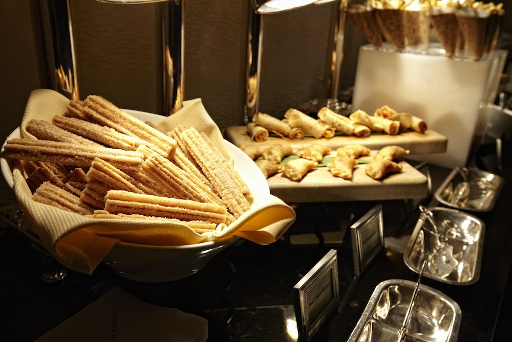 Churros at wedding reception with empanadas and other Mexican appetizers