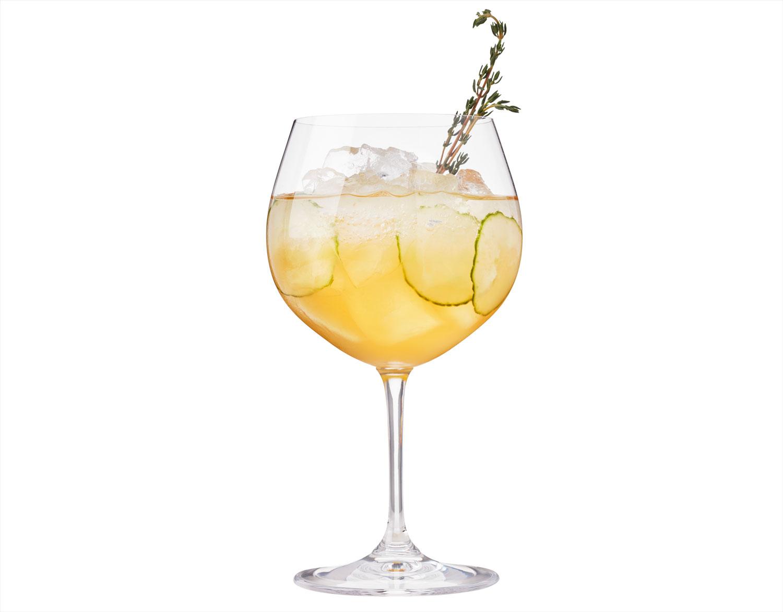 The Windsor Knot cocktail with gin, orange liqueur, lemon juice, cranberry juice, cucumber slices, club soda