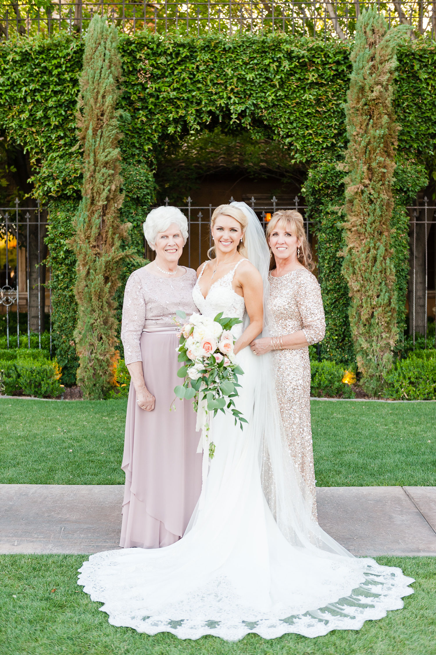 Bride with mother and grandmother three generation wedding photo