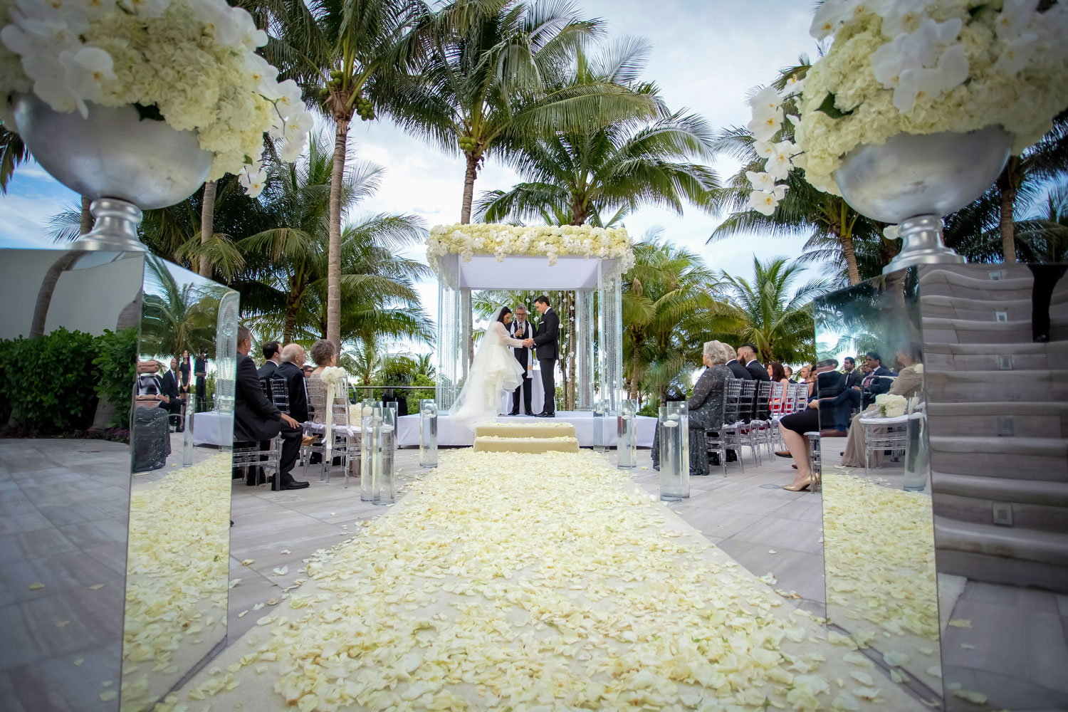 Wedding ceremony white flowers outside florida