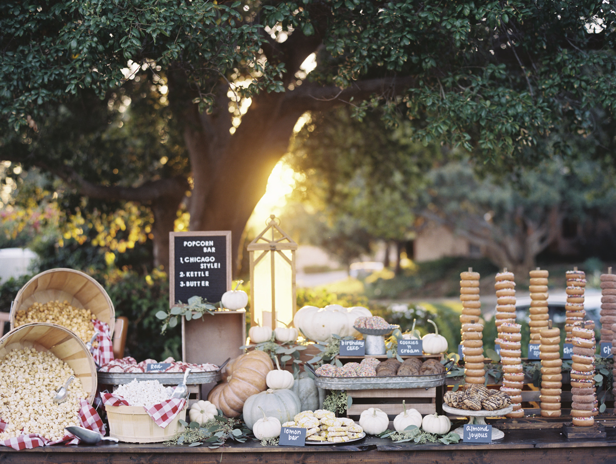 National donut day tower of donuts on dessert and snack table outdoor wedding doughnut