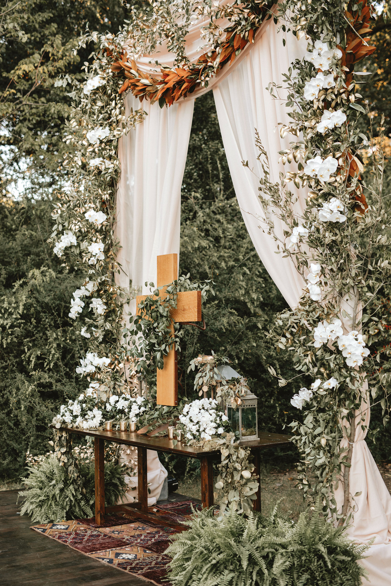 Inside Weddings Summer 2018 issue preview outdoor greenery boho wedding ceremony cross