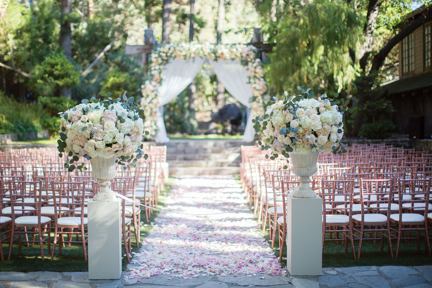 Inside Weddings Summer 2018 issue preview outdoor wedding ceremony rose gold chairs