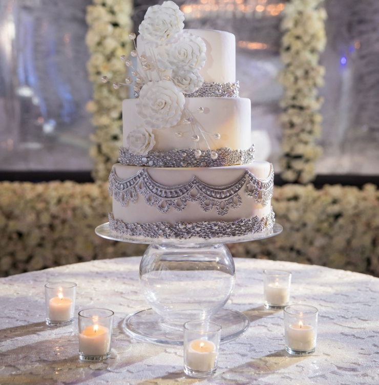 Wedding cake on table with candle votives candlelight wedding ideas