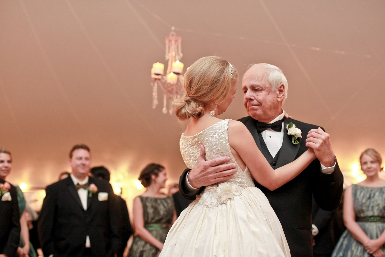 Touching photo of bride dancing with father at wedding reception