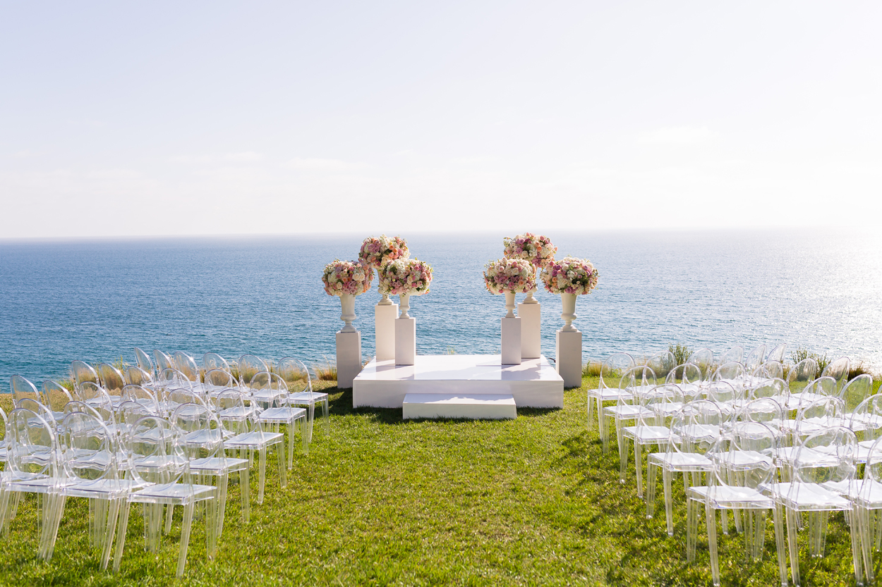 Outdoor wedding ceremony in the summer months overlooking ocean pros and cons