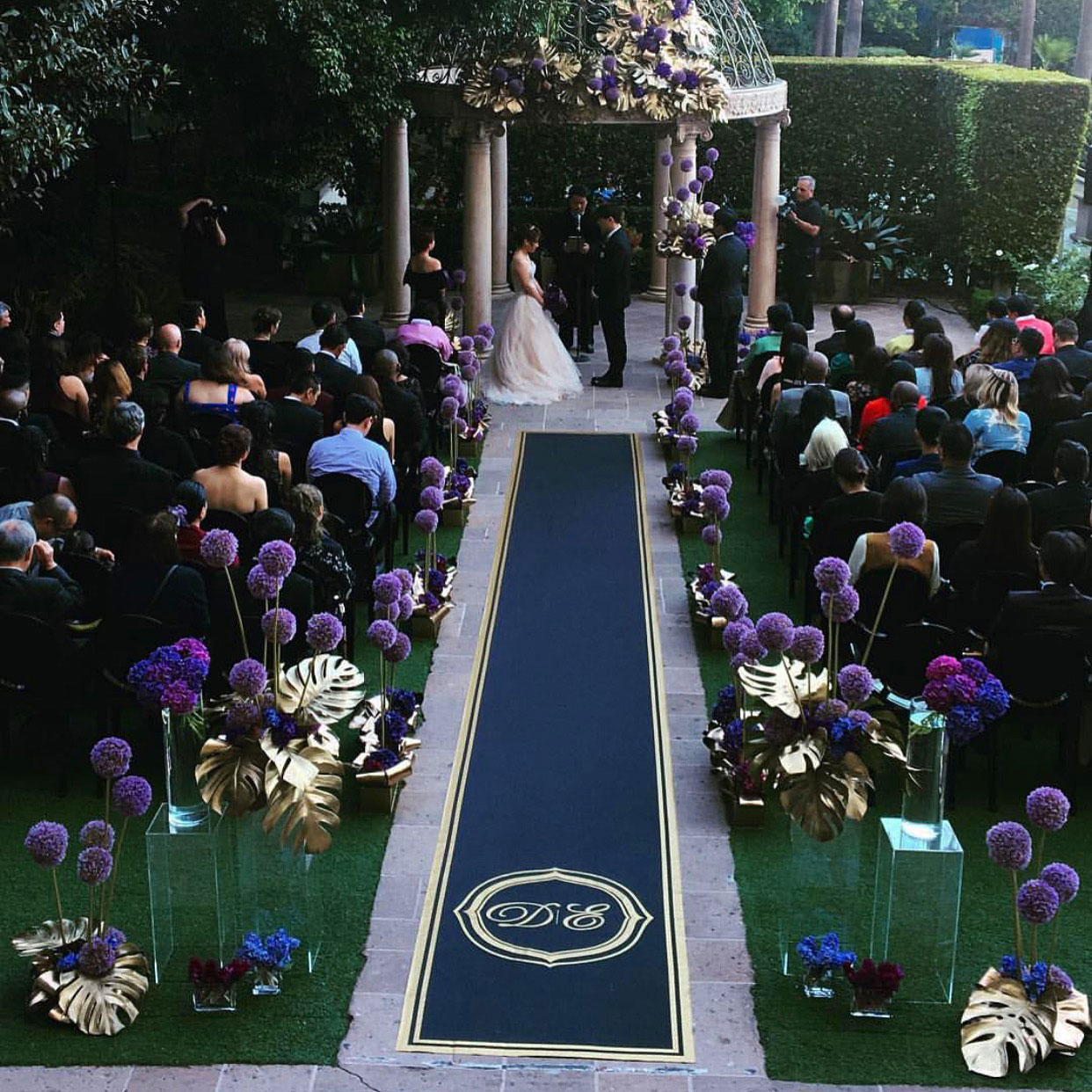 Dark aisle runner at ceremony from The Original Runner Company