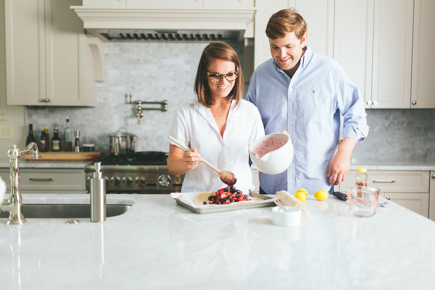 At home engagement session photo shoot in the kitchen e-session ideas baking berry dessert