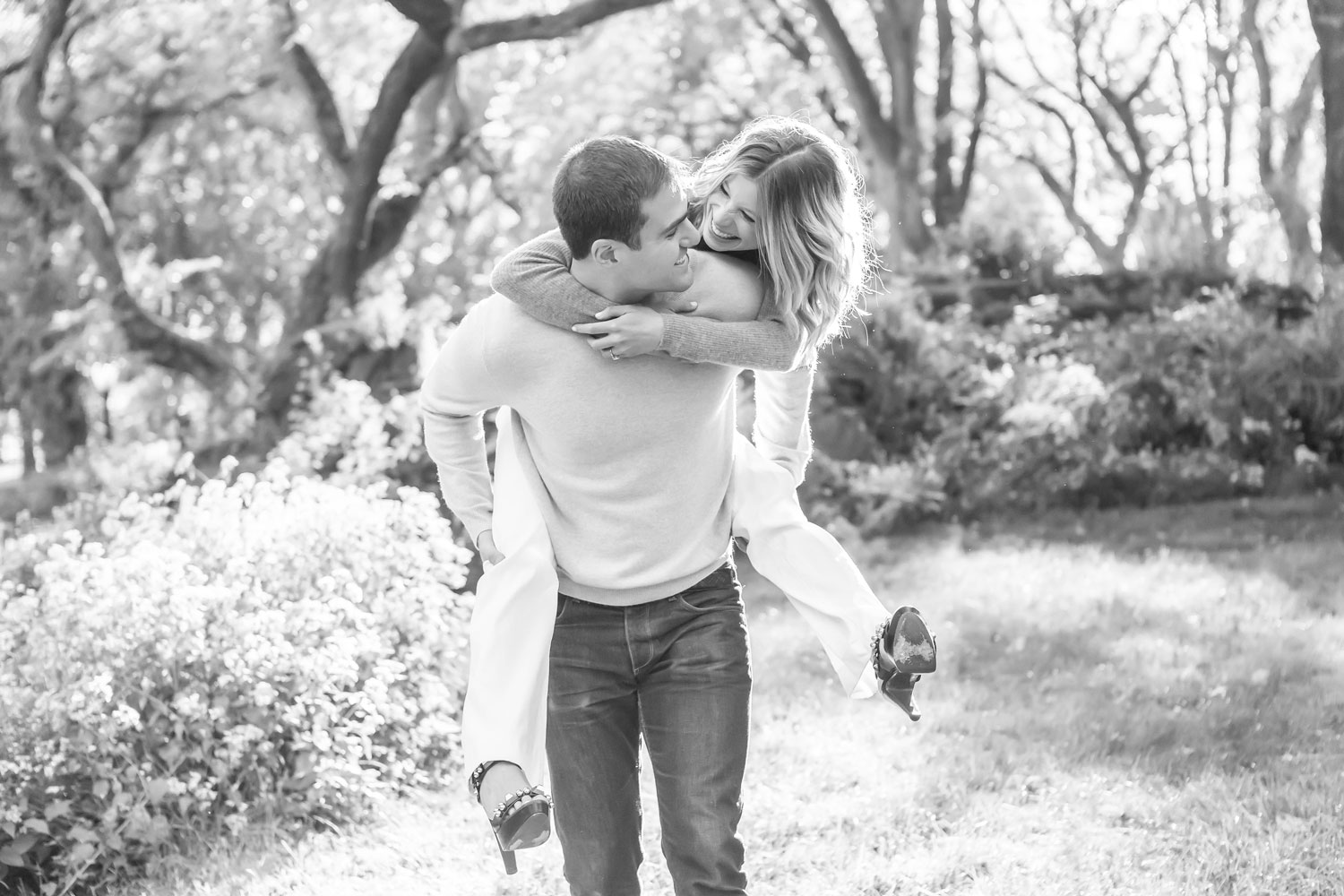 engagement shoot ideas black and white photo piggyback central park e-session