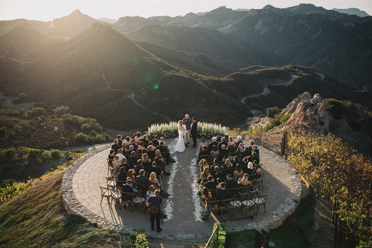 Outdoor wedding ceremony golden hour helipad malibu mountain canyon views