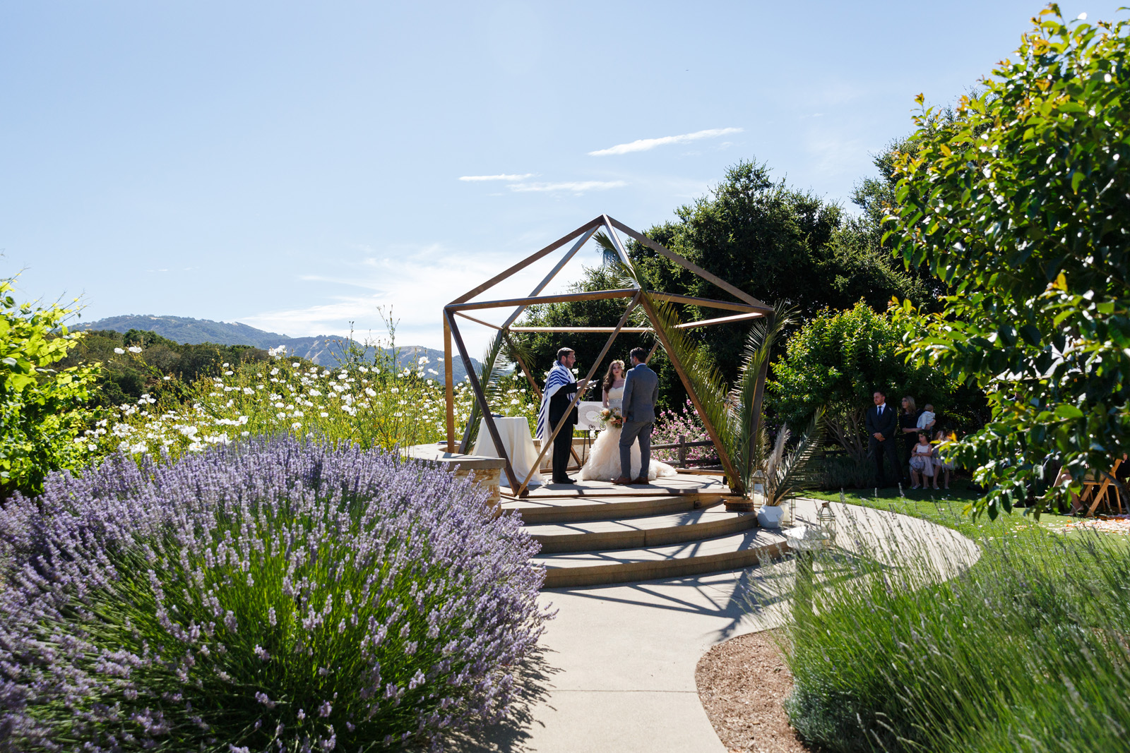 Outdoor wedding ceremony geometric ceremony structure gardens