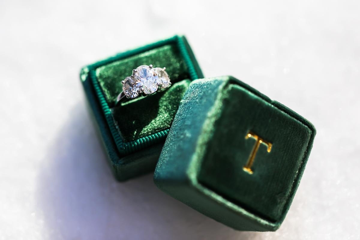 engagement ring in emerald green velvet ring box