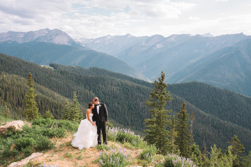 Bride and groom with pretty backdrop landscape tall trees