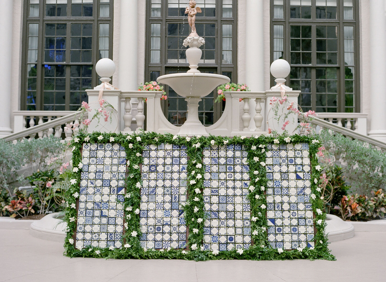 Escort card display greenery moss blue white tiles with seating assignment escort cards