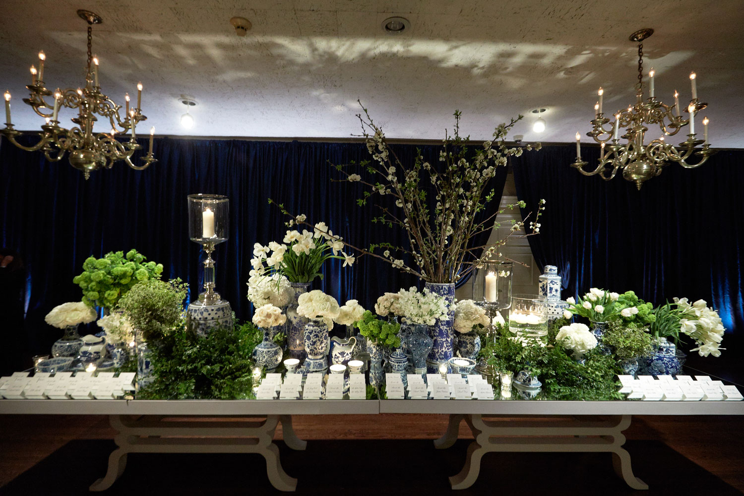 Escort card table at wedding reception entrance blue and white vase ginger jar chinoiserie decor