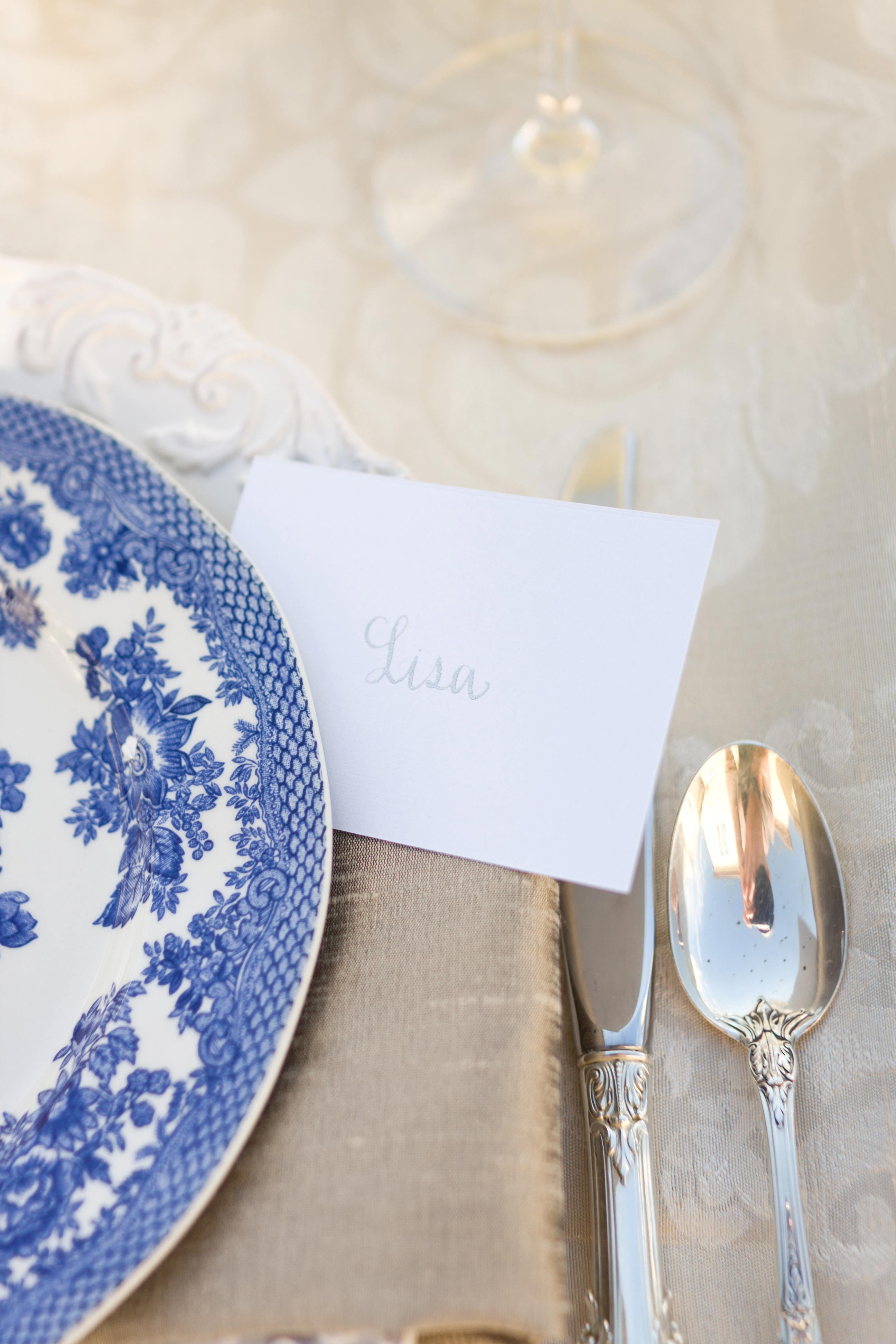 Seating place card calligraphy with blue and white china chinoiserie decor bridal shower