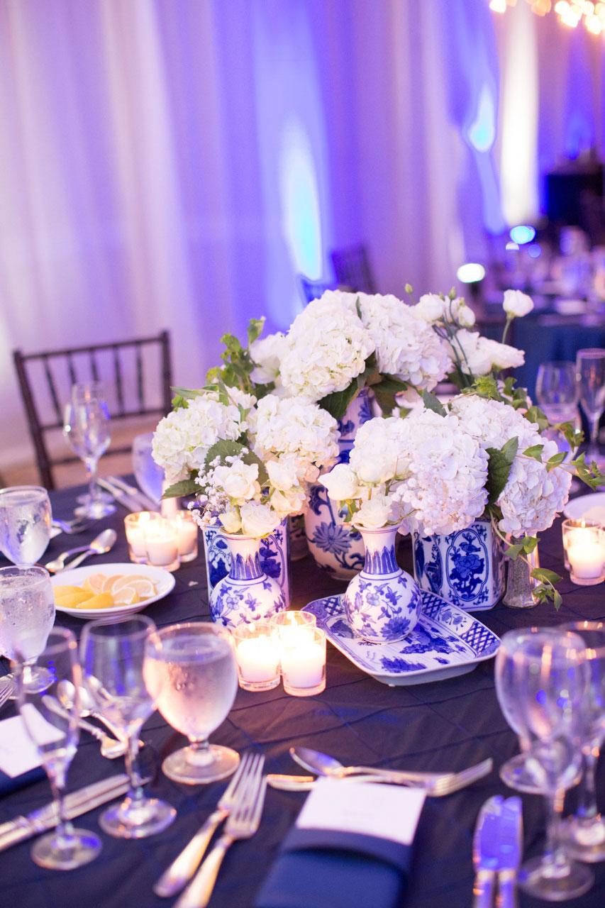 Purple lighting at wedding reception blue and white vase ginger jar chinoiserie decor
