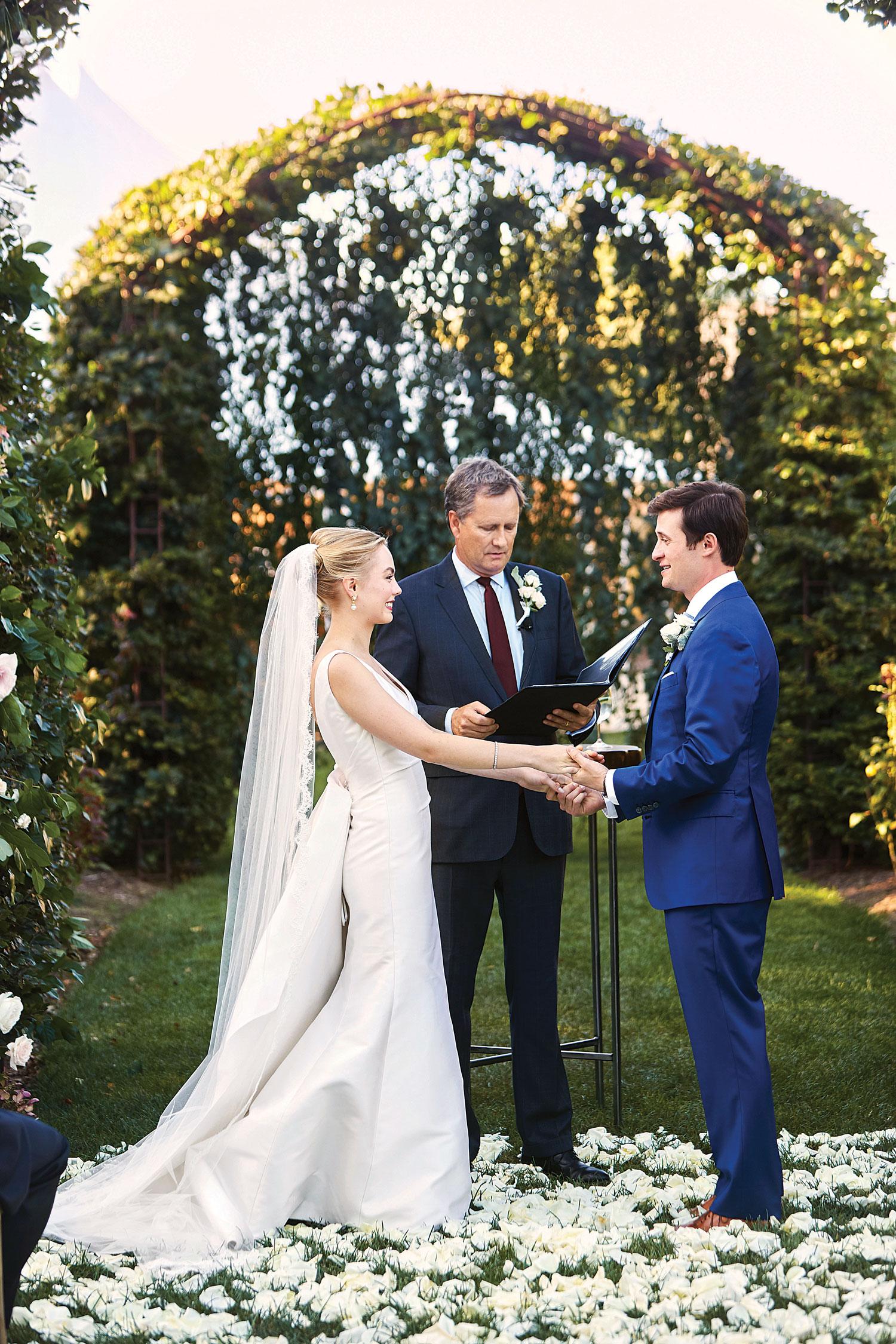 Johnson wedding ceremony arch outdoor ceremony mark ingram atelier Inside Weddings fall 2018 issue