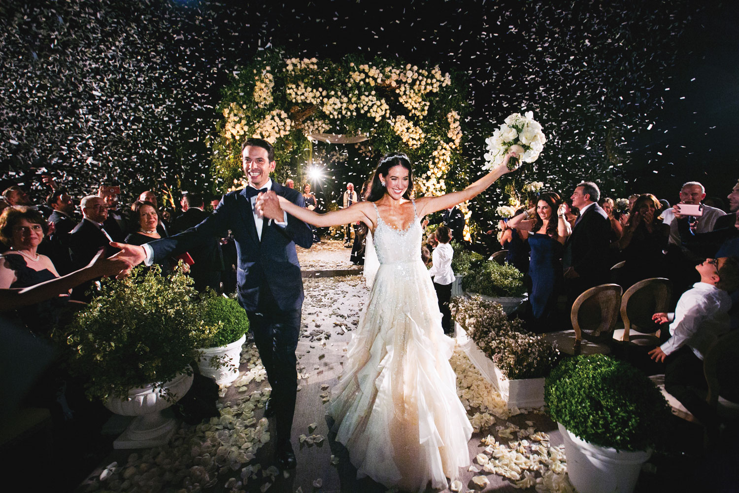 Bride and groom grand exit ceremony recessional levine fox revelry event designers Inside Weddings fall 2018 issue