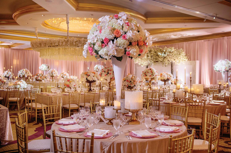 Pink white and gold wedding reception decor ballroom luxury wedding akeem clayton designs Inside Weddings fall 2018 issue