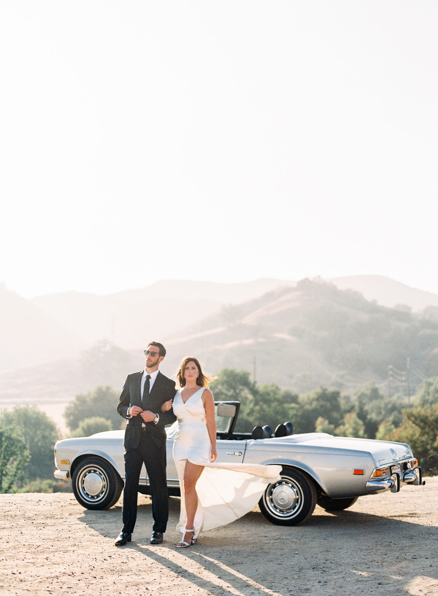 Engagement shoot photo ideas malibu classic car vintage mustang convertible bride with silk dress slit