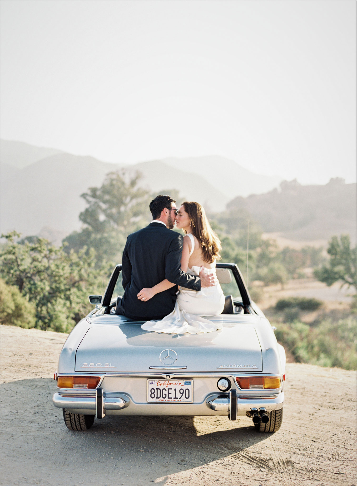 Engagement shoot photo ideas malibu classic car vintage mustang convertible kiss on back of car