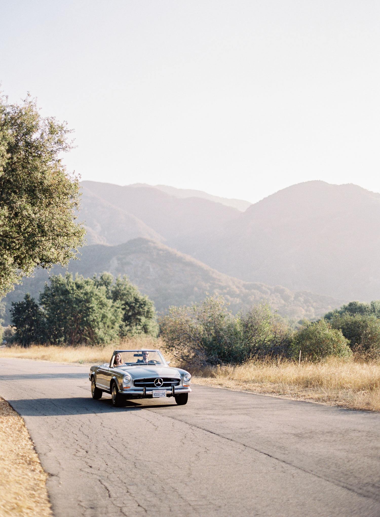 Engagement shoot photo ideas malibu classic car vintage mustang convertible driving in car malibu state park