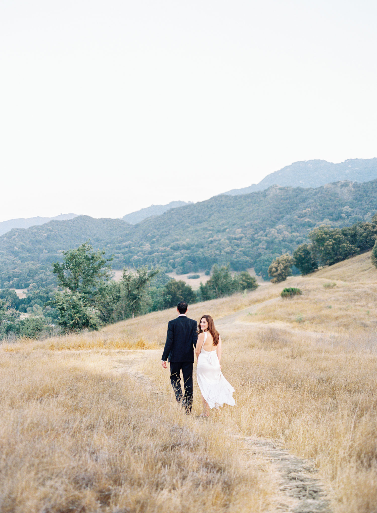 Engagement shoot photo ideas malibu classic car vintage mustang convertible walking in field
