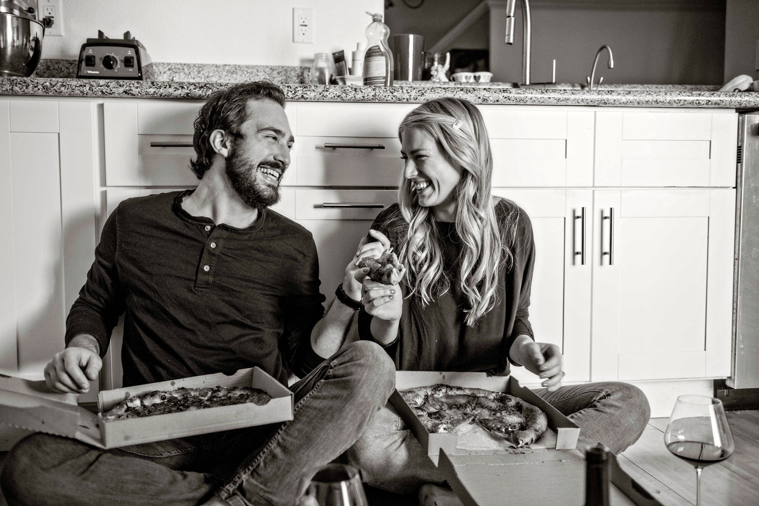 Engagement photo shoot at home on kitchen floor with pizza and wine Laurie Bailey Photography