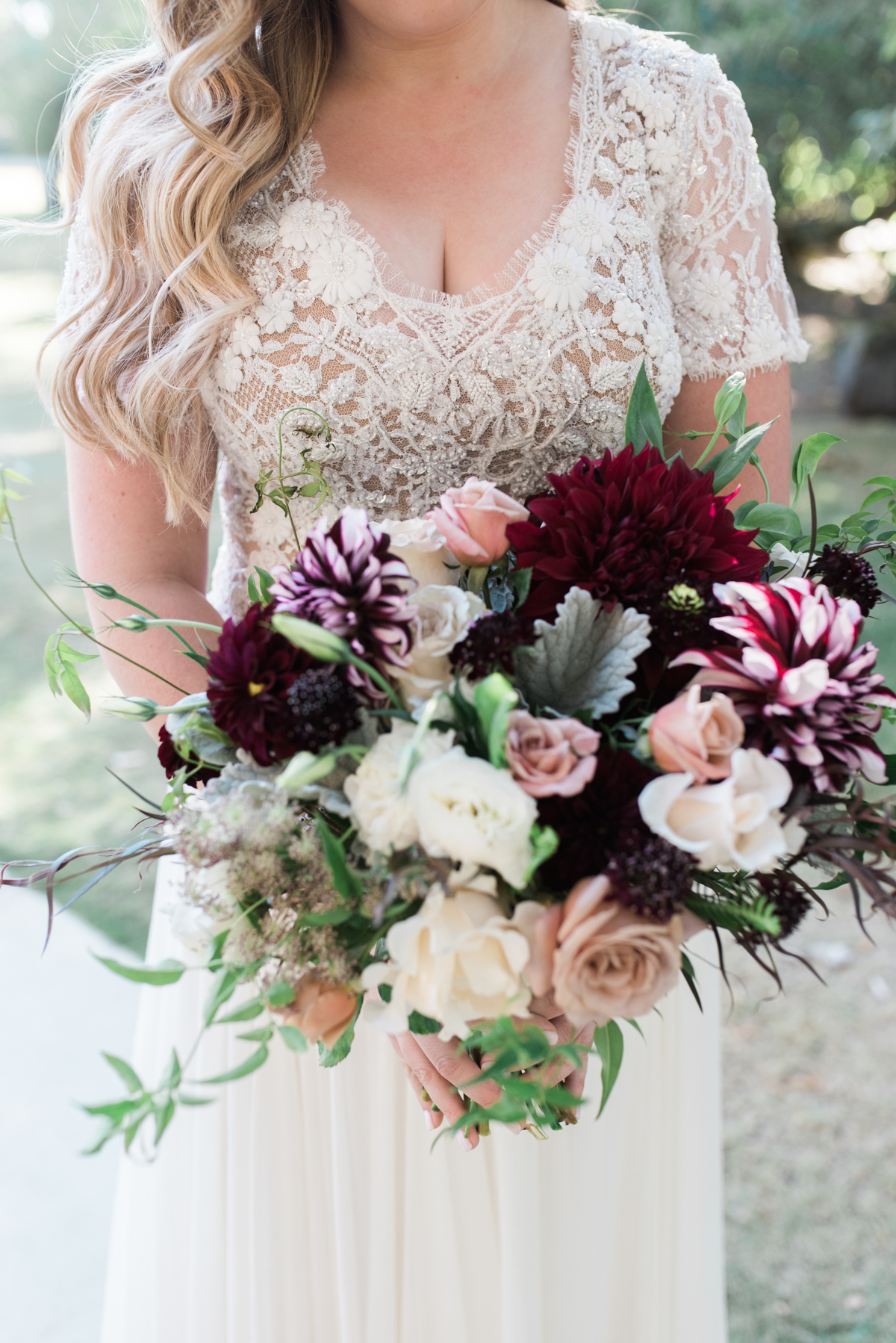 Bride in lace dress with bouquet fall autumn bouquet ideas weddings by susan dunne