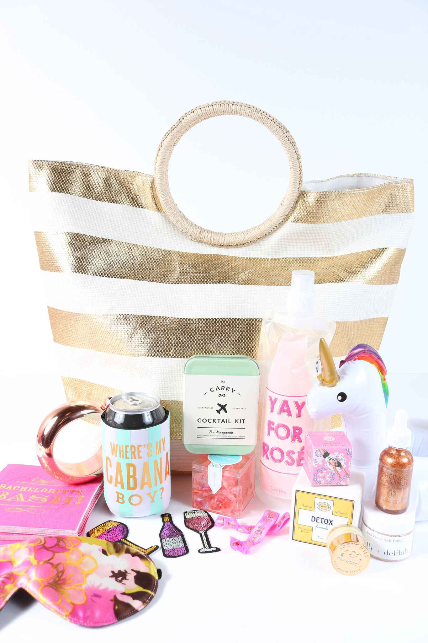 Wedding welcome bag striped tote bag with goodies inside The Welcome Bag Committee Jordan Payne