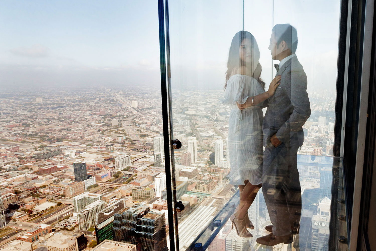 Engagement shoot in Chicago e-session sears tower willis tower observation deck view of city