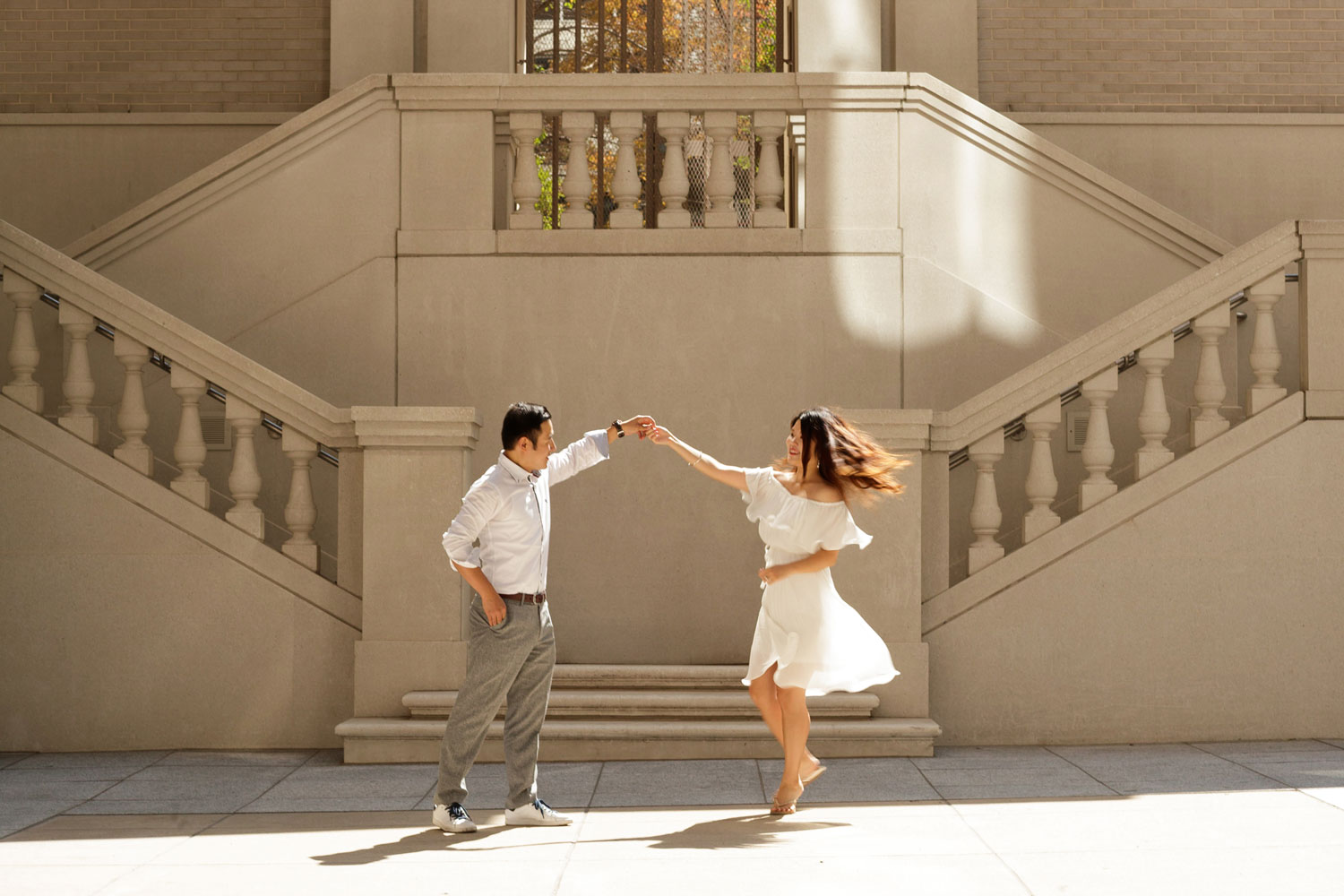 Engagement shoot in Chicago e-session twirling dancing in front of staircase