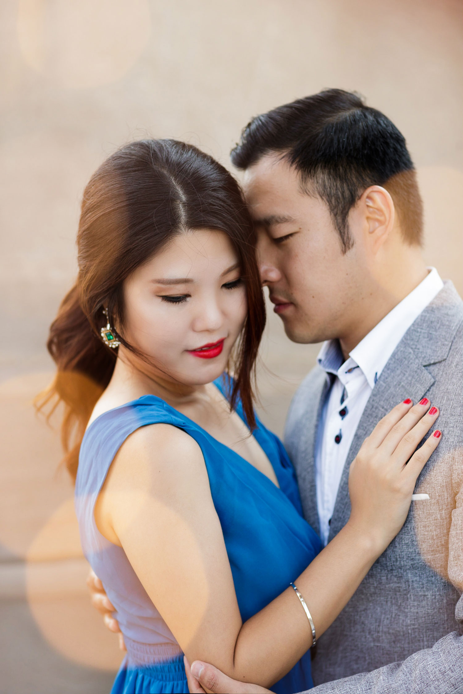 Engagement shoot in Chicago e-session close up bride in blue dress emerald earrings