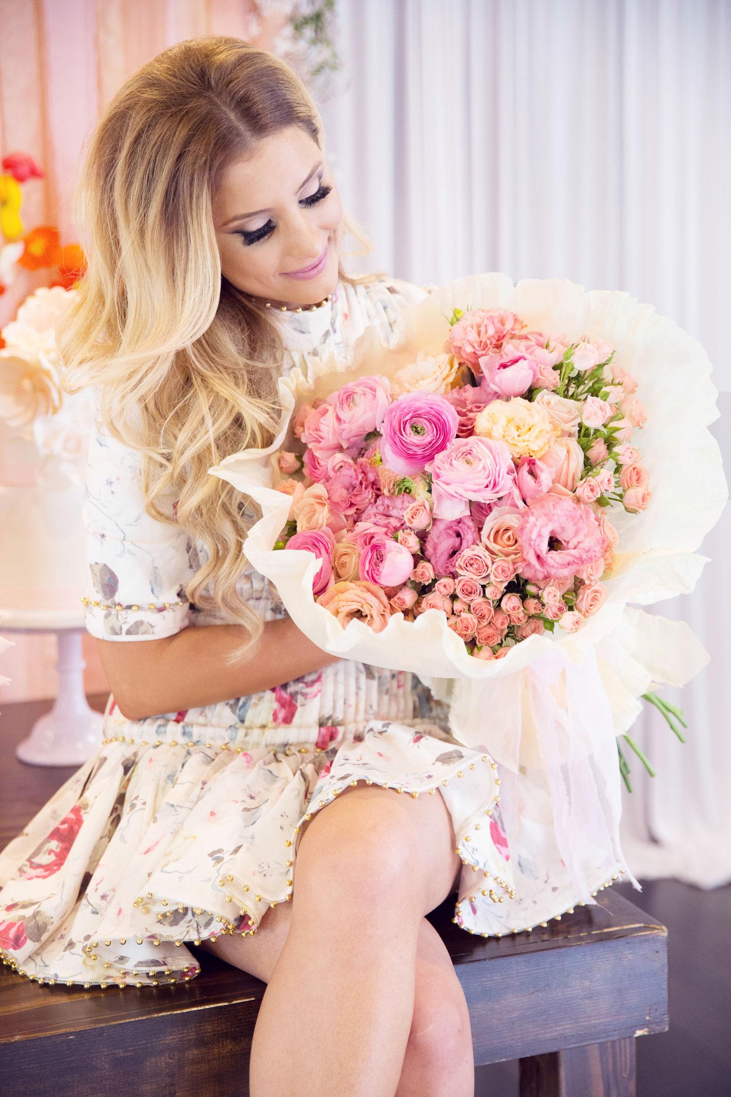 bride at bridal shower holding pink bouquet eddie zaratsian lifestyle and design