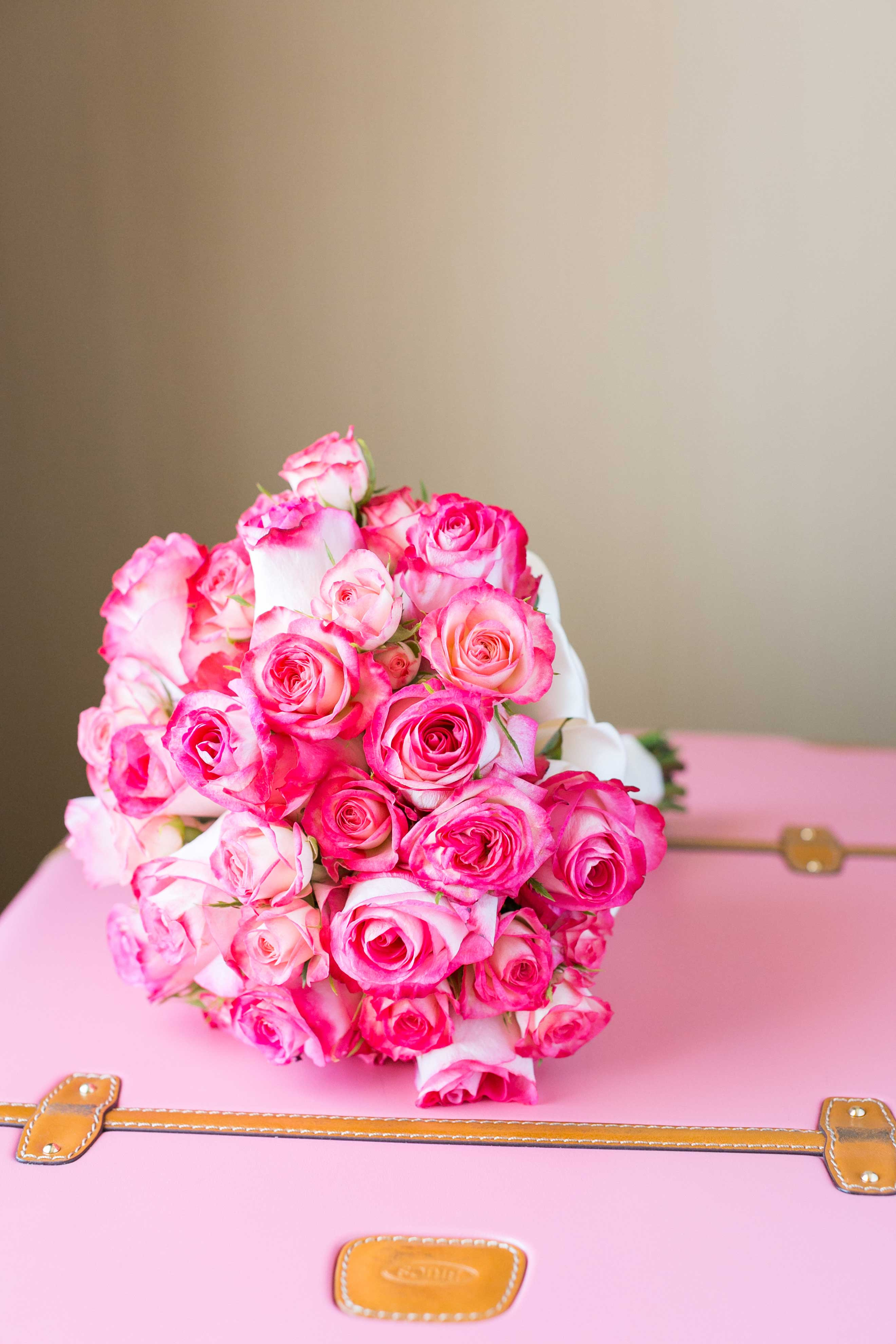 Pink rose bouquet on top of pink suitcase wedding ideas