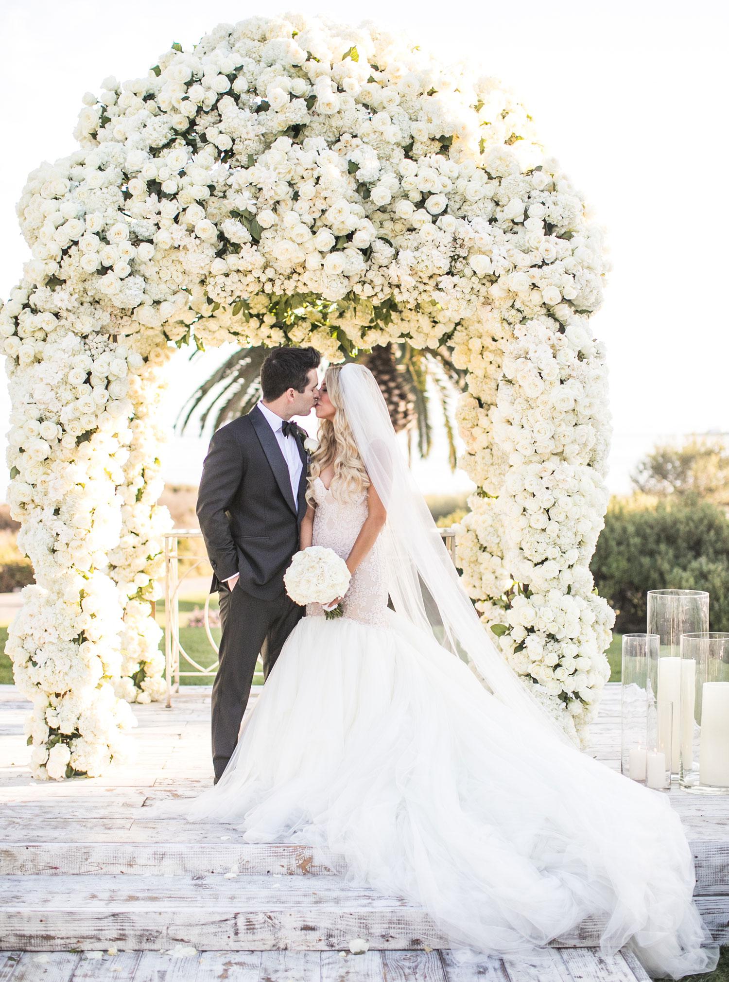 Real bride in Galia Lahav wedding dress sweetheart neckline mermaid gown lush flower ceremony chuppah