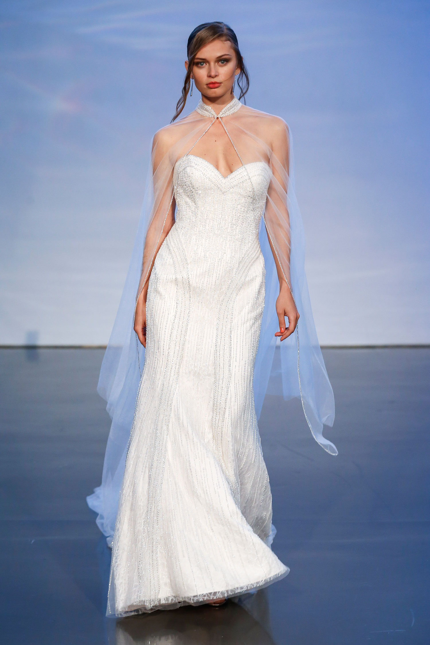 Halloween-inspired wedding dress with cape justin alexander fall 2019