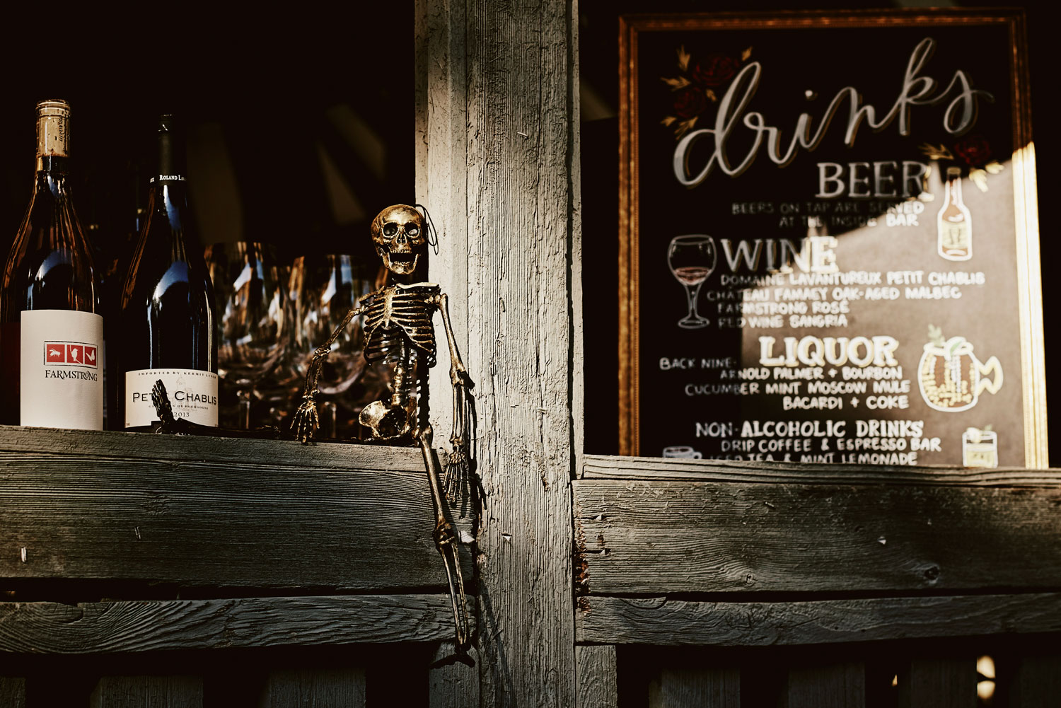 Wedding with halloween theme skeleton decor at bar