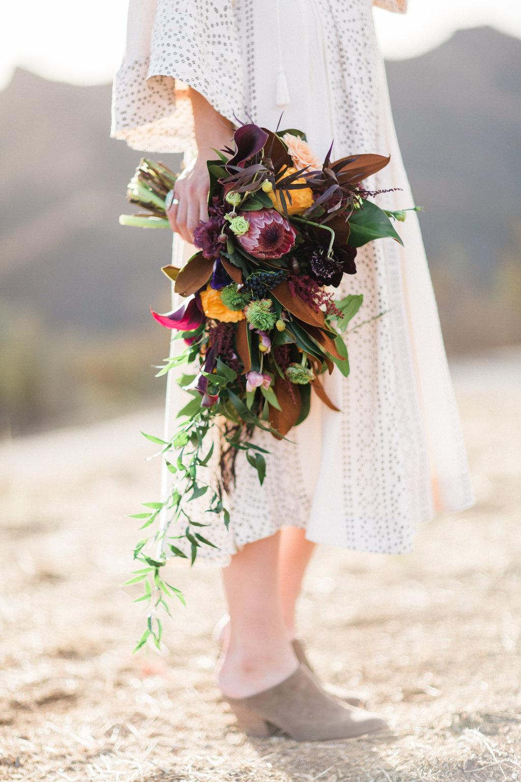 Bold bohemian boho wedding bouquet magnolia protea flowers