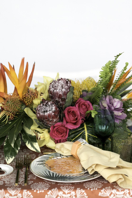 Tropical wedding tablescape centerpiece with protea flowers protea wedding flower ideas