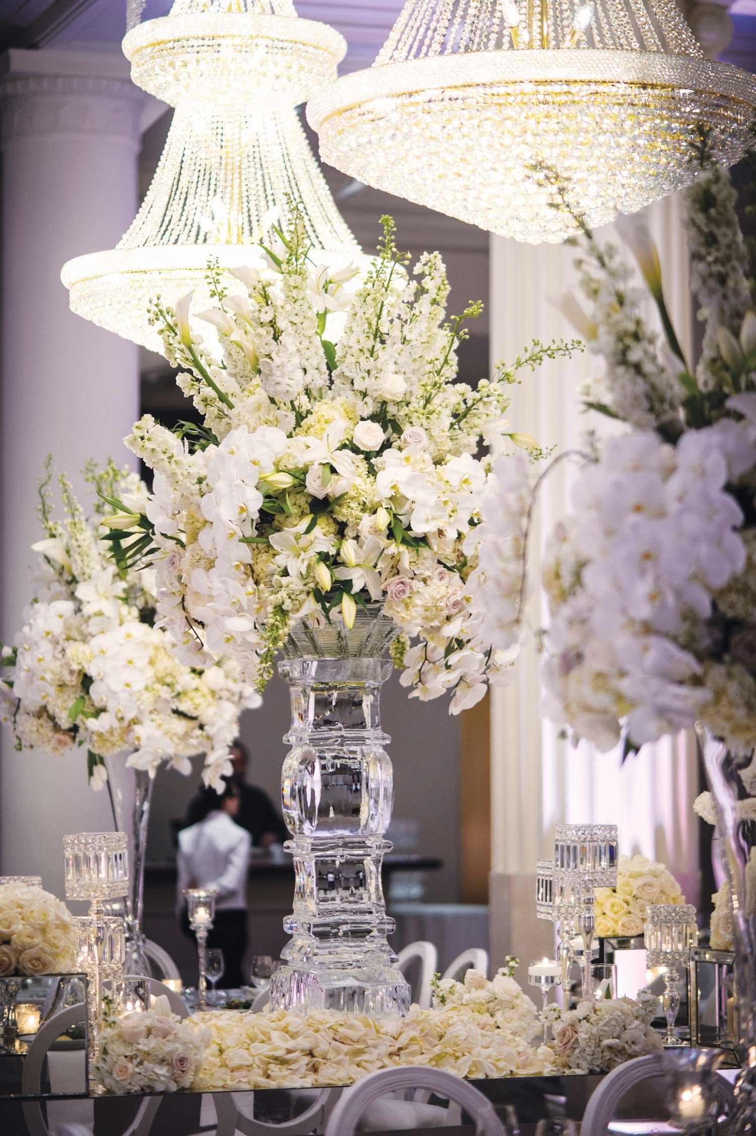 inside weddings winter 2019 issue preview white centerpiece wedding reception chandelier